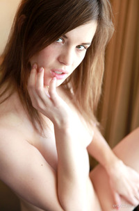 Alexis Displays Her Nubile Body