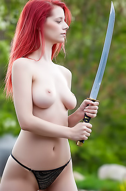 Redhead Ariel Erotic Modeling With A Sword