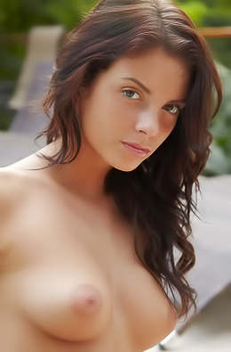 Naked Brunette Anastasia Shows Her Perky Tits By The Pool