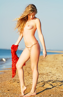 Naked babe plays with warm sea water.