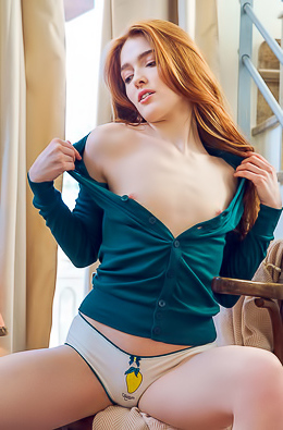 Sexy redhead Jia Lissa poses beside the stairs