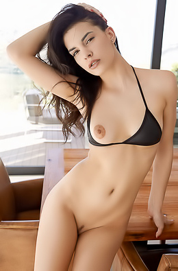 Luscious Candice Luka flicks her long brunette hair