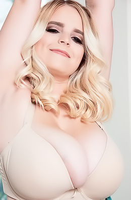 Busty Blonde Shows Her Huge Boobs