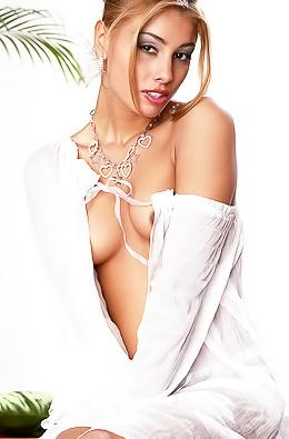 Aneta Smrhova In White Shirt Toying On Loveseat